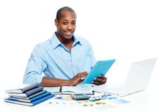 Black man working with tablet computer Stock Photo