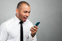 black man yelling at the cellphone Stock Images