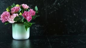 Black marble counter with vase of pink lisianthus flowers with copy space. Black marble counter benchtop with vase of pink Eustoma lisianthus flowers with copy royalty free stock images