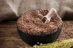 Black marble mortar full of flax seeds Royalty Free Stock Image