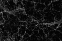 Black marble patterned (natural patterns) texture background. Stock Image