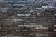 Black marble stone wall. Background of modern black marble stone wall  texture Royalty Free Stock Photo