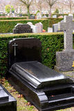 Black Marble tombstones in French cemetery Royalty Free Stock Image