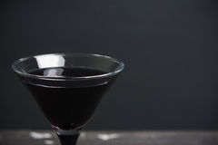 Black martini cocktail on the rustic background. Shallow depth of field Royalty Free Stock Image