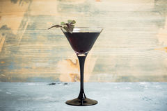 Black martini cocktail on the rustic background. Shallow depth of field stock photos