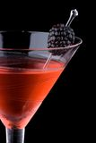 Black martini - Most popular cocktails series. Martini in chilled glass over black background on reflection surface. Red color, made with blackberry liqueur and stock images