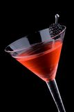Black martini - Most popular cocktails series. Martini in chilled glass over black background on reflection surface. Red color, made with blackberry liqueur and stock photos