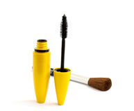 Black mascara and a brush for makeup. On white background Stock Photos