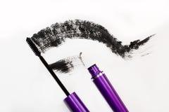 Black mascara. Brush and smear of carcass, Stock Images