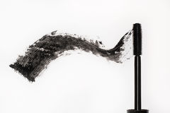 Black mascara. Brush and smear of carcass, Royalty Free Stock Images