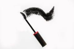 Black mascara. Brush and smear of carcass, Royalty Free Stock Image