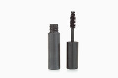 A black mascara brush and tube Royalty Free Stock Photography