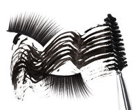 Black mascara stroke, brush and false eyelashes Royalty Free Stock Images