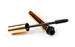Black mascara wand and tube isolated on white Royalty Free Stock Photos