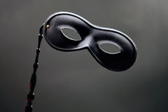 Black Mask. Black theatrical mask with smoke grey background Royalty Free Stock Images
