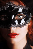 Black mask. Close-up portrait of a beautiful elegant woman in carnival mask stock images