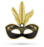 Black mask with golden feathers Stock Photo