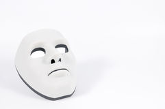 Black mask hidden behind white, human behaviour Stock Image