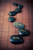 Black massage stones Stock Photography