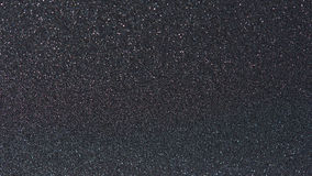 Black matte surface. With dots sparkle. Pattern of matt texture background stock images