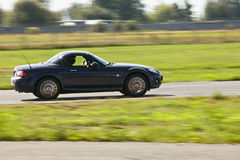 Black Mazda car sideview-aug27 Royalty Free Stock Image