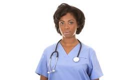 Black medical nurse. Black nurse wearing scrubs on white isolated background Stock Photo
