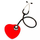 Black medical stethoscope and heart Royalty Free Stock Photo
