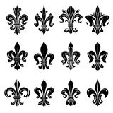 Black medieval royal fleur-de-lis symbols Royalty Free Stock Photos