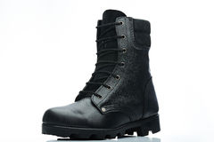 Black men boot. Black men leather combat boot with softer leather in the middle Royalty Free Stock Photos