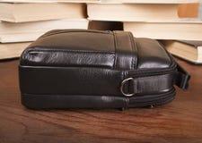 Black men`s bag. Leather bag on a wooden background Stock Images