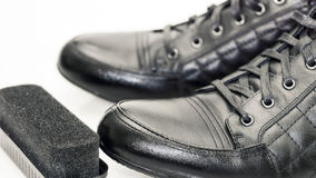 Black men's boots and sponge for shoes Royalty Free Stock Image
