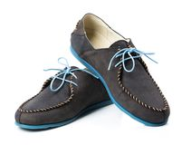 Black men's leather loafers with blue soles and laces on a white Royalty Free Stock Photo
