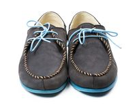 Black men's leather loafers with blue soles and laces on a white Stock Photography