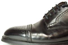 Black men's leather shoe. Stock Photos
