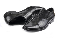 Black men's shoes. Pair of black men's shoes on a white background Stock Image