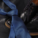 Black men's shoes and blu tie Stock Image
