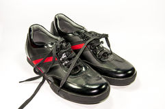 Black men shoes with red stripe,. Isolated by white background Stock Image