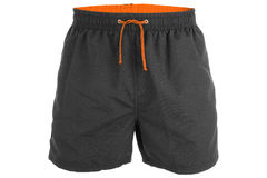 Black men shorts for swimming. Black and orange men shorts for swimming isolated on white background Royalty Free Stock Photography