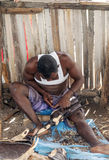 Black men wood carving workshop. In Tanzania, picture taken in May 2014, it´s a vertical picture Stock Photo
