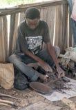Black men wood carving workshop Royalty Free Stock Images