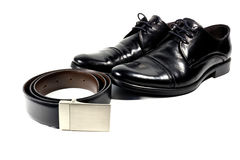 Black mens shoes and belt isolated on white background Royalty Free Stock Images