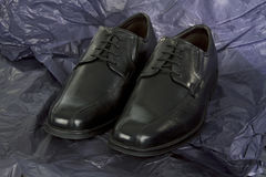 Black Mens shoes on black Paper Royalty Free Stock Photo