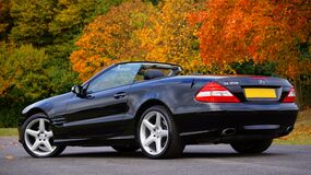 Black Mercedes Benz Convertible on Gray Concrete Floor Stock Image