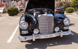 Black 1961 Mercedes Benz 300d. Laguna Beach, CA, USA - October 2, 2016: Black 1961 Mercedes Benz 300d owned by Barry Sohnen and displayed at the Rotary Club of Royalty Free Stock Photography