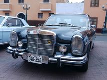 Black Mercedes-Benz 280 S exhibited in Lima. Lima, Peru. December 4, 2016. Front and side view of a mint condition black Mercedes-Benz 280 S sedan automatic Royalty Free Stock Photography