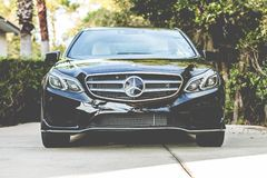 Black Mercedes Benz Sedan Parked Beside Green Plant Stock Image