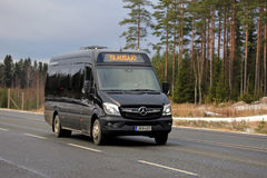 Black Mercedes-Benz Sprinter Minibus on the Road. LOUKKU, FINLAND - NOVEMBER 5, 2016: Black Mercedes-Benz minibus drives along highway in light early winter Royalty Free Stock Images