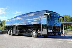 Black Mercedes-Benz Travego Coach Bus. SALO, FINLAND - JUNE 14, 2014: Black Mercedes-Benz Travego bus stops at bus parking. At IIA, Daimler presents the Safety Royalty Free Stock Images
