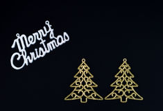 Black merry Christmas card. With golden christmas trees Royalty Free Stock Photos