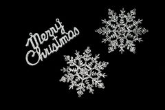 Black merry Christmas card. With two giant snowflakes Royalty Free Stock Photos